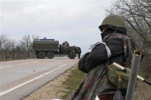 An armed man stands guard at the entrance to Belbek…