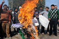 Activists burn an effigy during a protest in Amritsar on January 10, 2013 over the deaths of two Indian soldiers, apparently at the hands of Pakistani troops. Pakistan accused Indian troops of opening fire and killing a Pakistani soldier on Thursday, the third deadly cross-border incident reported in five days in the disputed Kashmir region