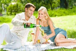 Couple having picnic with champage