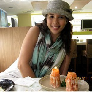 Karylle trying the Sakae Candle in Sakae Sushi in Singapore.