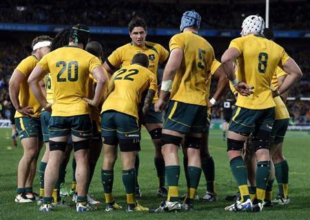 Australian Wallabies players react after the New Zealand All Blacks scored another try during their Bledisloe Cup rugby test match at Stadium Australia in Sydney