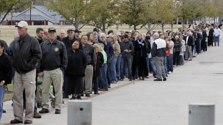 People wait in line to attend a memorial service for Christopher Kyle at Cowboys Stadium, Monday, Feb. 11, 2013, in Arlington, Texas. Thousands are expected to attend the public memorial service for Kyle, the former Navy SEAL sniper who was shot to death at a Texas shooting range. (AP Photo/Brandon Wade)