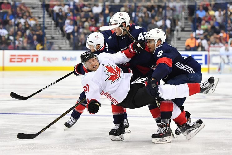 COLUMBUS, OH - SEPTEMBER 9: Steven Stamkos #91 of Team Canada is knocked to the ice by Matt Niskanen #2 of Team USA during the third period of an exhibition game on September 9, 2016 at Nationwide Arena in Columbus, Ohio. Team USA defeated Team Canada 4-2. (Photo by Jamie Sabau/World Cup of Hockey via Getty Images)