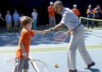 President Barack Obama plays tennis with Harrison Carter, 7, at the annual White House Easter Egg Roll Monday, April 21. (Photo via Twitter, @NerdyWonka)