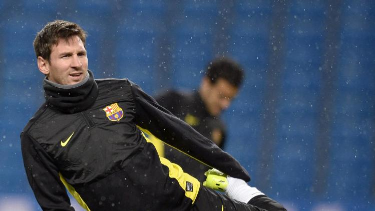 Barcelona's Lionel Messi stretches during a training session in Manchester