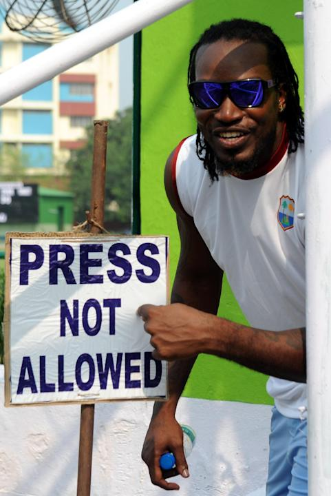 West Indian cricketer Chris Gayle during inauguration of a cricket ground, at Jadavpur University's Salt Lake campus in Kolkata on Oct.31, 2013. (Photo: IANS)