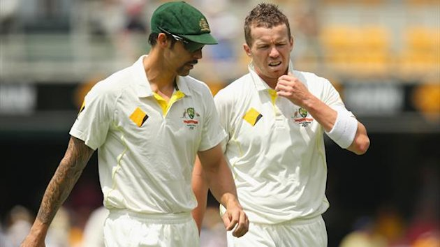 Mitchell Johnson of Australia speaks to Peter Siddle (Getty Images)