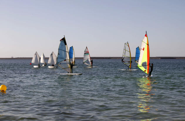 Libyans take part in a local windsurfing competition in Tripoli