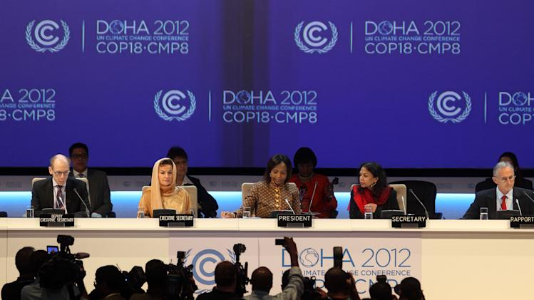 Organizers are seen on stage at the opening ceremony of the 18th United Nations climate change conference in Doha, Qatar, Monday, Nov. 26, 2012. U.N. talks on a new climate pact resumed Monday in oil and gas-rich Qatar, where negotiators from nearly 200 countries will discuss fighting global warming and helping poor nations adapt to it. The two-decade-old talks have not fulfilled their main purpose: reducing the greenhouse gas emissions that scientists say are warming the planet. (AP Photo/Osama Faisal)