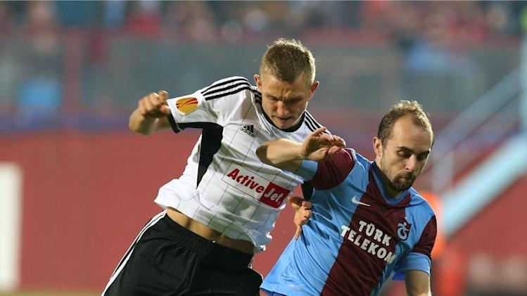 Trabzonspor's Adrian Mierzejewski, right, and Legia's Rzezniczak fight for the ball during their Europa League Group J soccer match in Trabzon, Turkey, Thursday Oct. 24, 2013. (AP Photo)