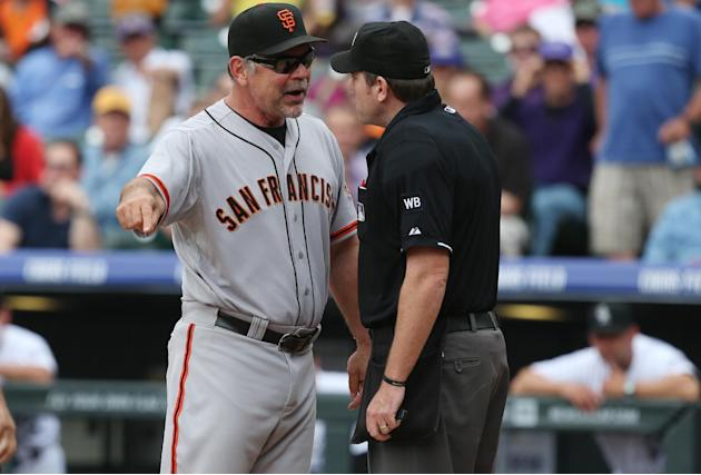 San Francisco Giants manager Bruce Bochy, left, argues with home plate umpire Chris Conroy after Conroy ejected Bochy in the fourth inning of a baseball game against the Colorado Rockies in Denver, We