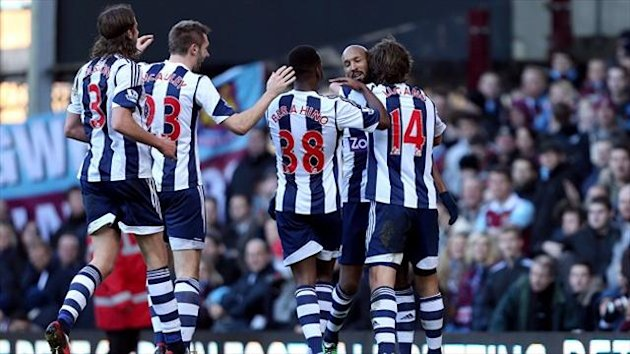 Nicolas Anelka, centre, is mobbed after scoring West Brom's second goal