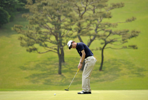 This handout photo provided by AsiaOne shows Kang Wook-soon of South Korea during the 31st GS Caltex Maekyung Open Golf Championship at the Nam Seoul Golf and Country Club in Seoul on May 10, 2012.  T