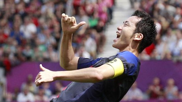 Maya Yoshida of Japan celebrates scoring a goal during their men's quarterfinal match against Egypt at the London 2012 Olympic Games at Old Trafford in Manchester, August 4, 2012