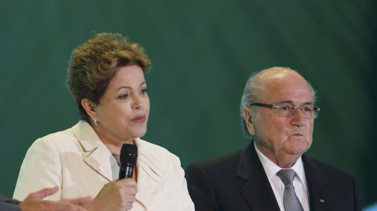 Rousseff speaks during the draw for the 2014 World Cup in Sao Joao da Mata