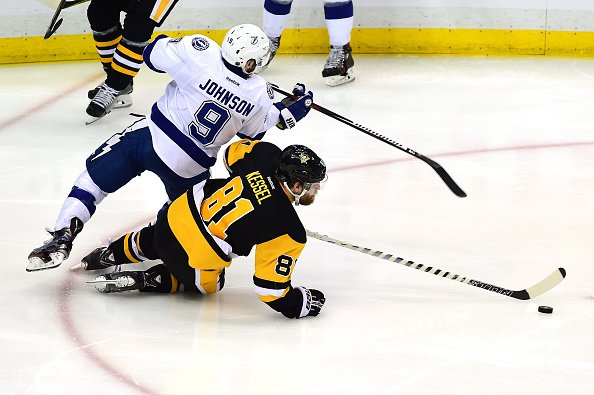 PITTSBURGH, PA - MAY 22: Tyler Johnson #9 of the Tampa Bay Lightning collides with Phil Kessel #81 of the Pittsburgh Penguins during the third period in Game Five of the Eastern Conference Final during the 2016 NHL Stanley Cup Playoffs at Consol Energy Center on May 22, 2016 in Pittsburgh, Pennsylvania. (Photo by Matt Kincaid/Getty Images)