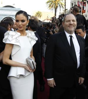 CORRECTS ID TO GEORGINA CHAPMAN Designer Georgina Chapman, left and Harvey Weinstein arrive before the 84th Academy Awards on Sunday, Feb. 26, 2012, in the Hollywood section of Los Angeles. (AP Photo/Chris Carlson)