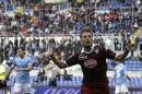 Torino forward Ciro Immobile celebrates after scoring during an Italian Serie A soccer match between Lazio and Torino at Rome's Olympic stadium, Saturday, April 19, 2014. (AP Photo/Alessandra Tarantino)