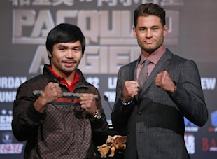 Manny Pacquiao, left, and Chris Algieri pose for photographers during a news conference in Macau. (AP)