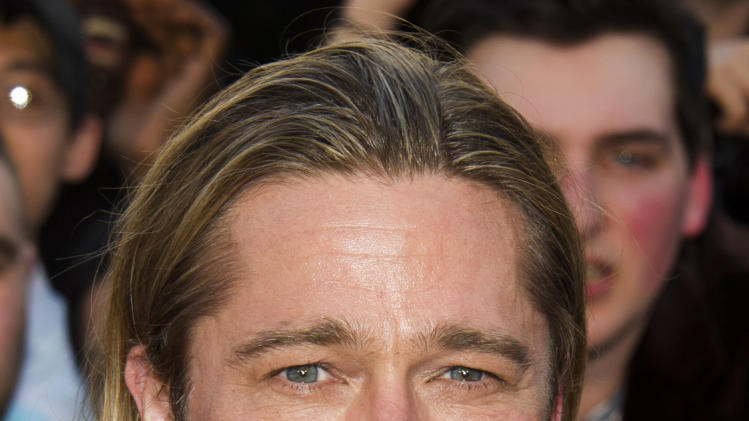 "Brad Pitt attends the ""World War Z"" premiere on Monday, June 17, 2013, in New York. (Photo by Charles Sykes/Invision/AP)"