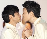 South Korean film director Kim Jho Gwang-soo (L) kisses his partner Kim Seung-hwan during their wedding ceremony in central Seoul September 7, 2013. Kim Jho Gwang-soo married his long-term partner on Saturday in this conservative Asian country where homosexuality is still taboo and gays have been subjected to hate crimes. REUTERS/Lee Jae-Won