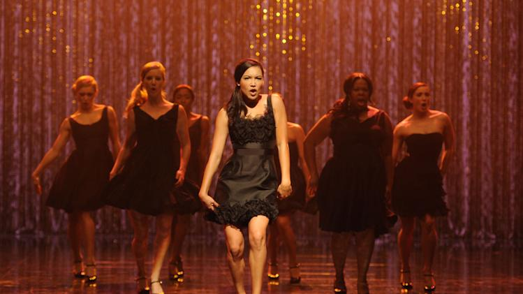 "This Wed., Oct. 26, 2011 publicity photo released by FOX shows Naya Rivera, center, performing the 300th song on the set of ""Glee.""  Fox said Friday, April 19, 2013,  it's renewed ""Glee"" for two more seasons. (AP Photo/FOX, Frank Micelotta)"