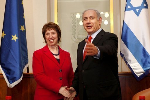 EU foreign policy chief Catherine Ashton shakes hands with Israeli Prime Minister Benjamin Netanyahu ahead of talks in Jerusalem on January 25. Ashton has met Netanyahu for a discussion focused on upcoming talks between world powers and Iran, an Israeli official told AFP