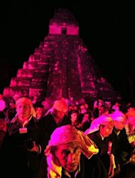 Guatemalan Mayan natives take part in celebrations marking the end of the Mayan era at the Tikal archaeological site, 560 kms north of Guatemala City, on December 21, 2012. A global day of lighthearted doom-themed celebration and superstitious scare-mongering culminated Friday in the jungle temples built by the Mayan people of Central America, whose calendar sparks fears of apocalypse.
