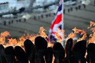 "This file photo shows the Olympic flame burning in the cauldron at the Olympic Stadium, on July 31. The Olympic closing ceremony on Sunday will be a ""beautiful, cheeky, cheesy, camp, silly and thrilling"" journey through British pop history, its musical director promised"