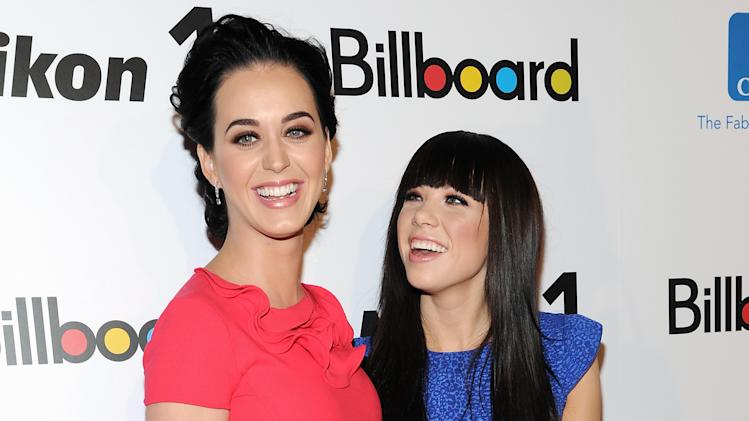 """Woman of the Year"" honoree Katy Perry, left, and ""Rising Star"" honoree Carly Rae Jepsen pose together at Billboard's ""Women in Music 2012"" luncheon at Capitale on Friday Nov. 30, 2012 in New York. (Photo by Evan Agostini/Invision/AP)"