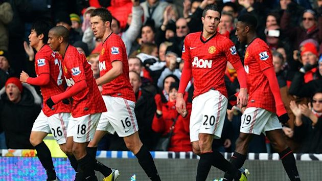 Robin van Persie and his Manchester United team-mates celebrate his opening goal against Liverpool at Old Trafford