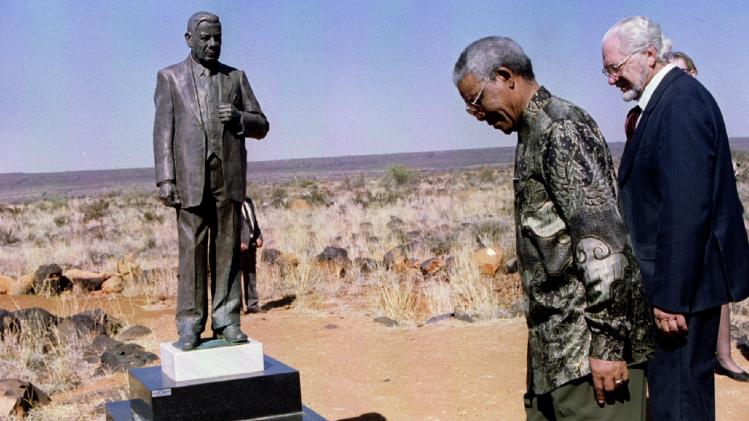 File photo of former President Nelson Mandela and Orania Movement founder Carel Boshoff inspecting a statue of Apartheid prime minister Hendrik Verwoerd