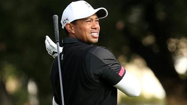 Tiger Woods drops his club during the Northwestern Mutual World Challenge at Sherwood Country Club on