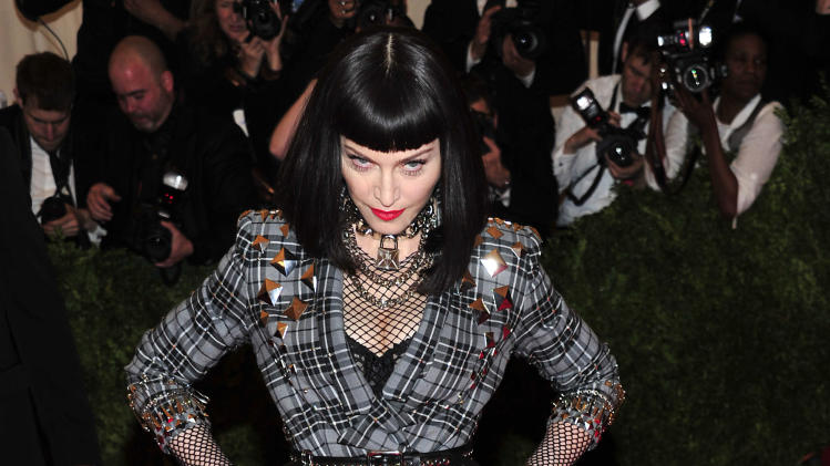 "Madonna attends The Metropolitan Museum of Art's Costume Institute benefit celebrating ""PUNK: Chaos to Couture"" on Monday May 6, 2013 in New York. (Photo by Charles Sykes/Invision/AP)"