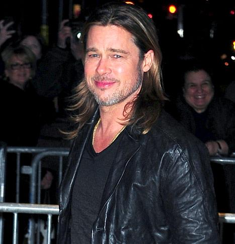 "Brad Pitt Tweets ""I'm Coming"" to China, Despite Ban"