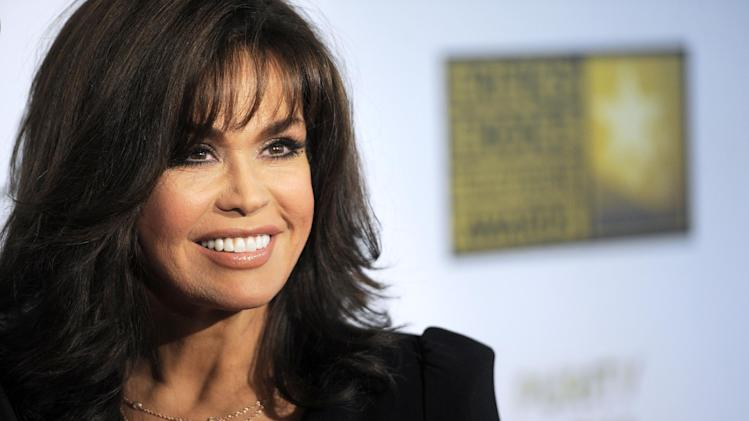 "FILE - This June 10, 2013 file photo shows TV host Marie Osmond at the Critics' Choice Television Awards in Beverly Hills, Calif. Hallmark Channel announced that they are canceling Osmonds' show ""Marie."" (Photo by Chris Pizzello/Invision/AP, File)"