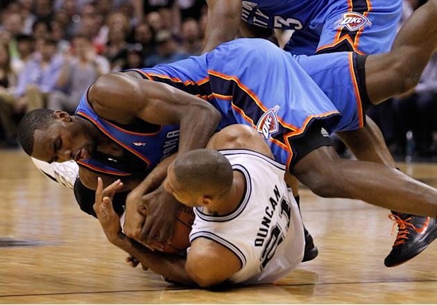 Serge Ibaka #9 Of The Oklahoma City Thunder And Tim Duncan #21 Of The San Antonio Spurs Battle For The Ball On The  Getty Images