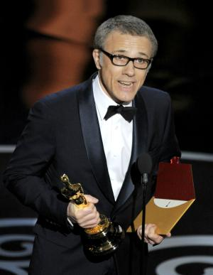 "Actor Christoph Waltz accepts the award for best actor in a supporting role for ""Django Unchained"" during the Oscars at the Dolby Theatre on Sunday Feb. 24, 2013, in Los Angeles.  (Photo by Chris Pizzello/Invision/AP)"