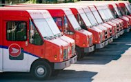 Canada Post vehicles sit outside a sorting depot in the Ville St-Laurent borough of Montreal, on June 6, 2011. THE CANADIAN PRESS/Graham Hughes