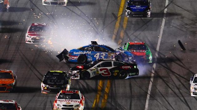 Daytona Beach, FL, USA; NASCAR Sprint Cup driver Aric Almirola (43) and NASCAR Sprint Cup driver Austin Dillon (3) wreck during the Daytona 500 at Daytona International Speedway.