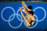 China's Chen Ruolin and Wang Hao compete in the women's synchronised 10m platform final at the London 2012 Olympic Games in London. They won gold