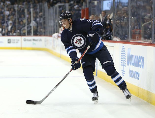 WINNIPEG, MANITOBA - OCTOBER 13: Patrik Laine #29, playing his first NHL game, of the Winnipeg Jets looks to make a pass against the Carolina Hurricanes during NHL action on October 22, 2016 at the MTS Centre in Winnipeg, Manitoba. (Photo by Jason Halstead /Getty Images)
