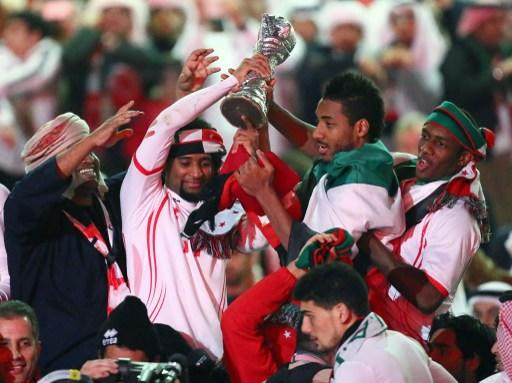 Emirati players celebrate with their trophy after winning the final of the 21st Gulf Cup on January 18, 2013 in Manama. United Arab Emirates won 2-1 against  Iraq.  AFP PHOTO/MARWAN NAAMANI
