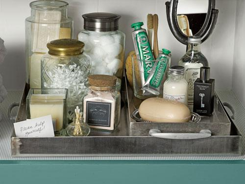 6. Corral toiletries in easy-to-tote trays