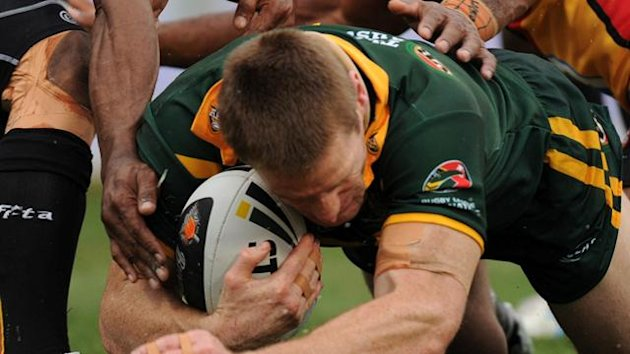 Australia's Brent Tate scores a try against Papua New Guinea during their Four Nations match at Parramatta Stadium, Sydney, Sunday, Oct. 24, 2010 (AAP AUSTRALIA USE ONLY)