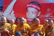 "Buddhist monks chant during a demonstration held by ""Red Shirt"" supporters in Bangkok on Saturday to mark the second anniversary of a deadly crackdown on street protests"