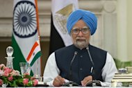 "Indian Prime Minister Manmohan Singh speaks in New Delhi on March 19, 2013. India's government is appealing to corporate leaders to ""keep the faith"" as it struggles to revive a staggering economy, but the reply from business is they need more than talk to win back their support"