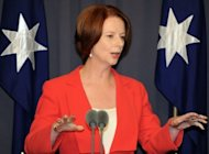 Australia has criticised Papua New Guinea's decision to delay national elections as disappointing and concerning, with Prime Minister Julia Gillard (pictured in February) urging Port Moresby to reconsider. Papua New Guinea's parliament voted overwhelmingly on Thursday to postpone the polls for six months