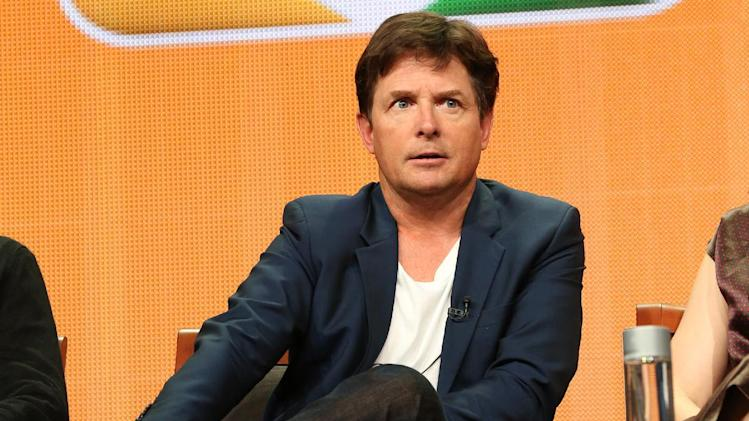 "This publicity image released by NBC shows actor Michael J. Fox from the ""The Michael J. Fox Show"" panel during the NBCUniversal Press Tour in Beverly Hills, Calif., on Saturday, July 27, 2013. Fox will star as Mike Henry, a former local NBC newscaster with Parkinson's. (AP Photo/NBC, Chris Haston)"