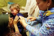 This file photo shows a girl crying as a medic injects a measles vaccination, in Lahore, in 2002. An outbreak of measles in part of Pakistan's lawless tribal northwest has killed 12 children in three weeks and is spreading due to a shortage of medicines, according to doctors